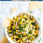 Corn salsa in a bowl with chips