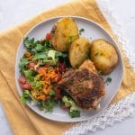 Plate with crock pot chicken and potatoes and a green salad