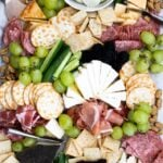 Costco cheese platter with cheese, meats, grapes, and more