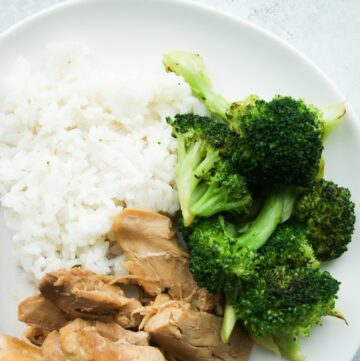 Plate with honey garlic chicken in the slow cooker with rice and broccoli