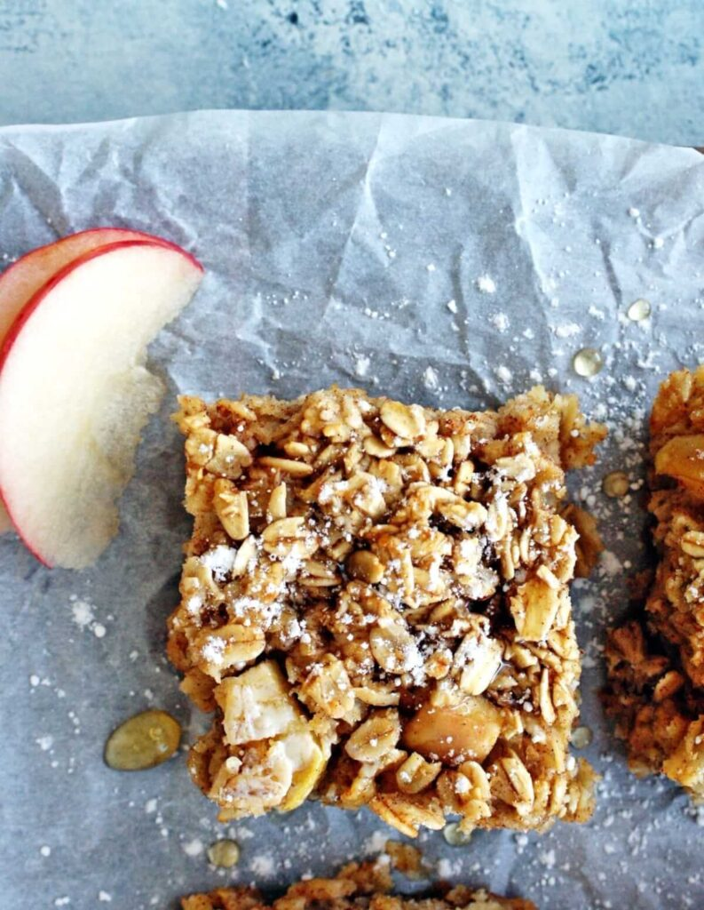 Baked oatmeal apple bars on parchment paper