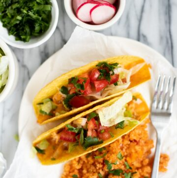 plate with baked chicken tacos