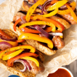 Sheet pan sausage and peppers in the oven - pinterest