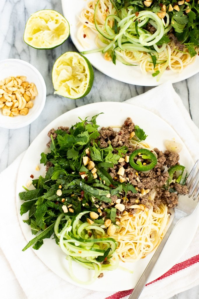 two plates of Thai ground beef stir fry with noodles