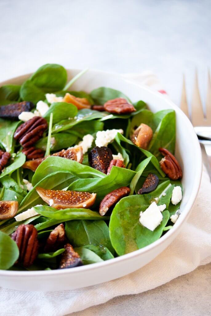 easy arugula salad in a white bowl