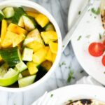 Bowl of cucumber and mango salad