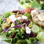 Side salad with cabbage, seeds, pickles and more