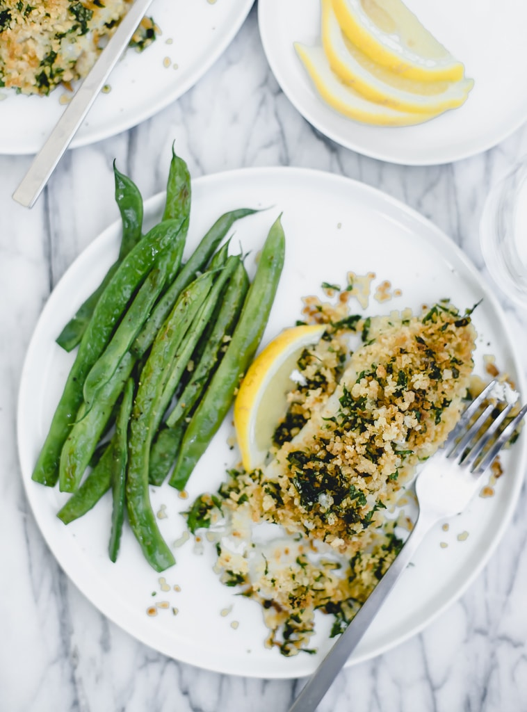 panko crusted fish with a bite out of it on a plate