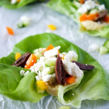 Lettuce cup with hummus and toppings