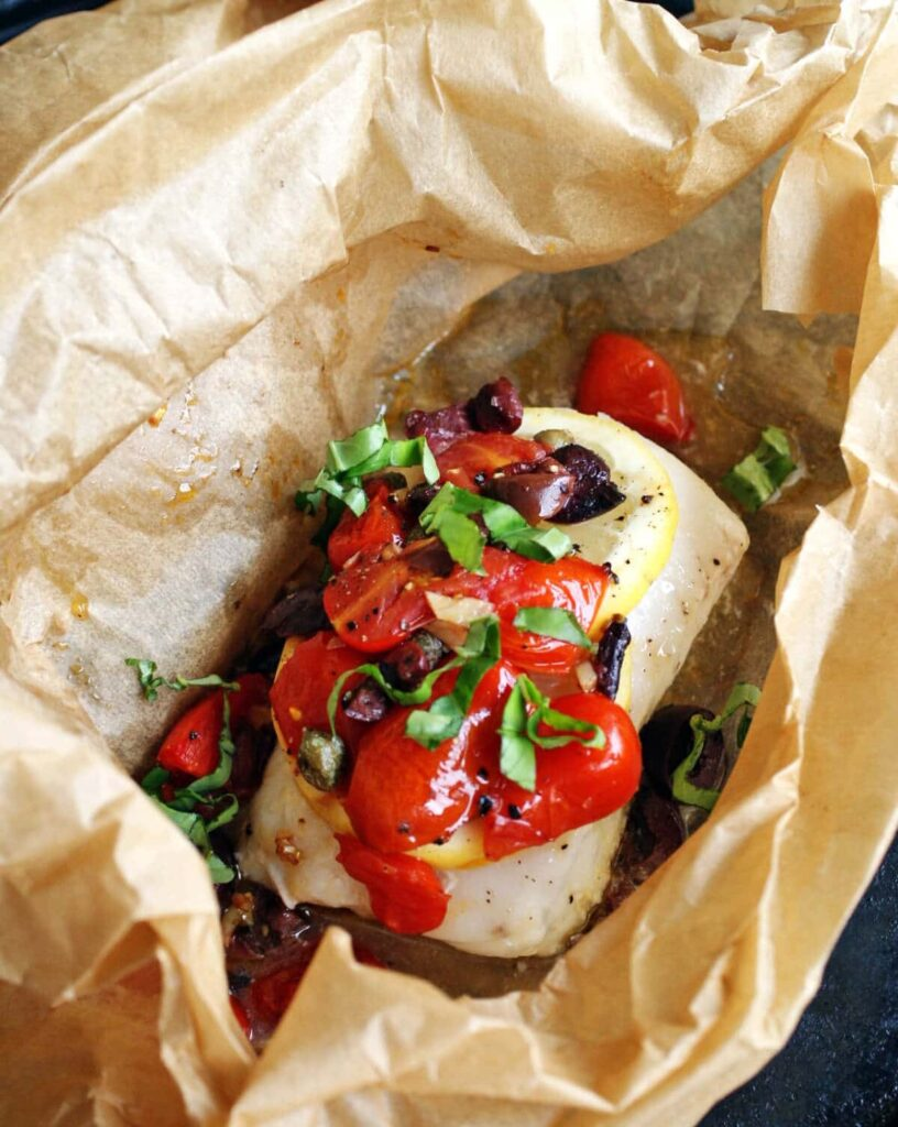 Mediterranean baked fish in parchment paper