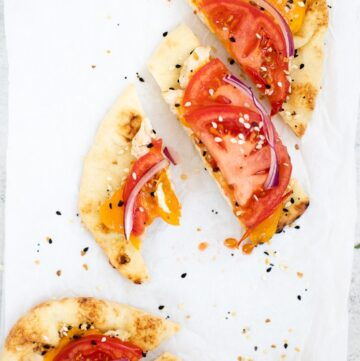 Slices of naan chicken melts with everything bagel seasoning