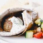 Pita sandwich with tzatziki sauce and salad
