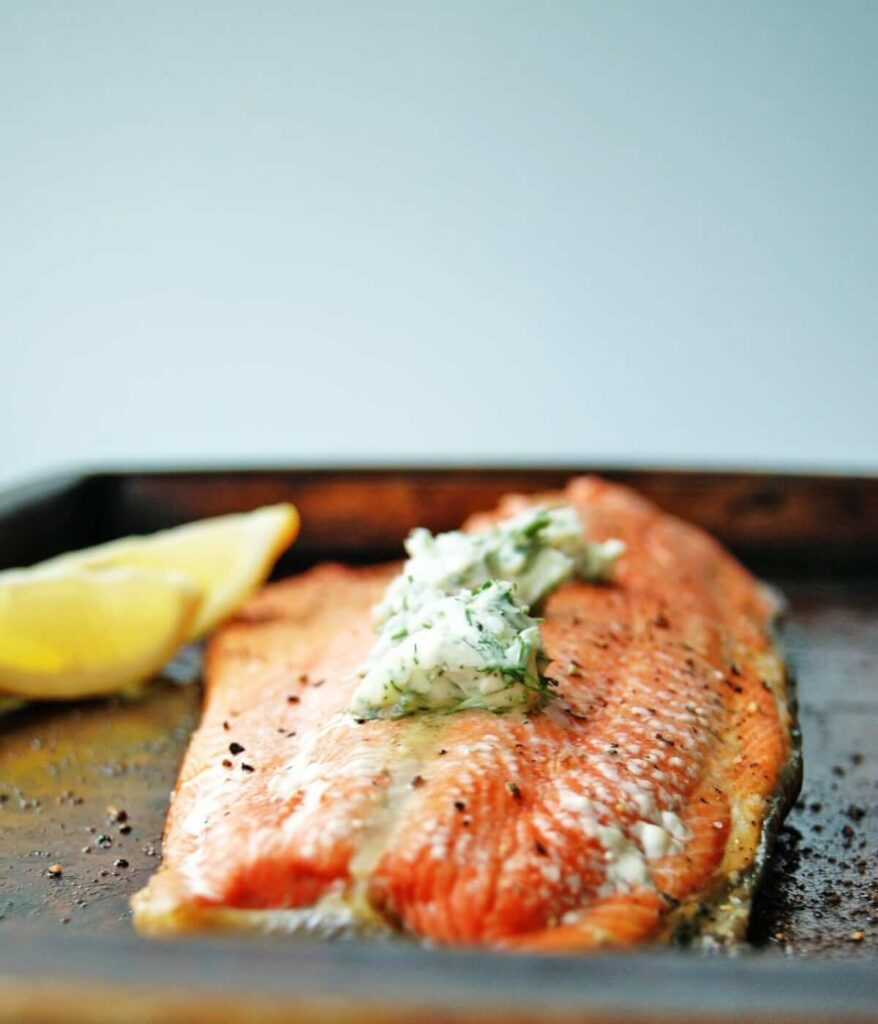 Baked salmon with lemon dill sauce for salmon on top