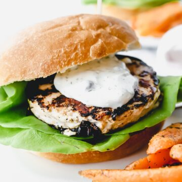 Frozen salmon burger on bun with dill sauce for salmon burger