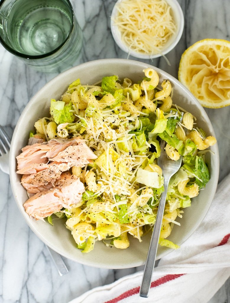 caesar salad with pasta in a bowl