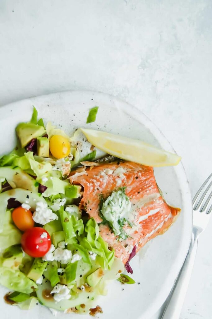 Plate of salmon with dill sauce