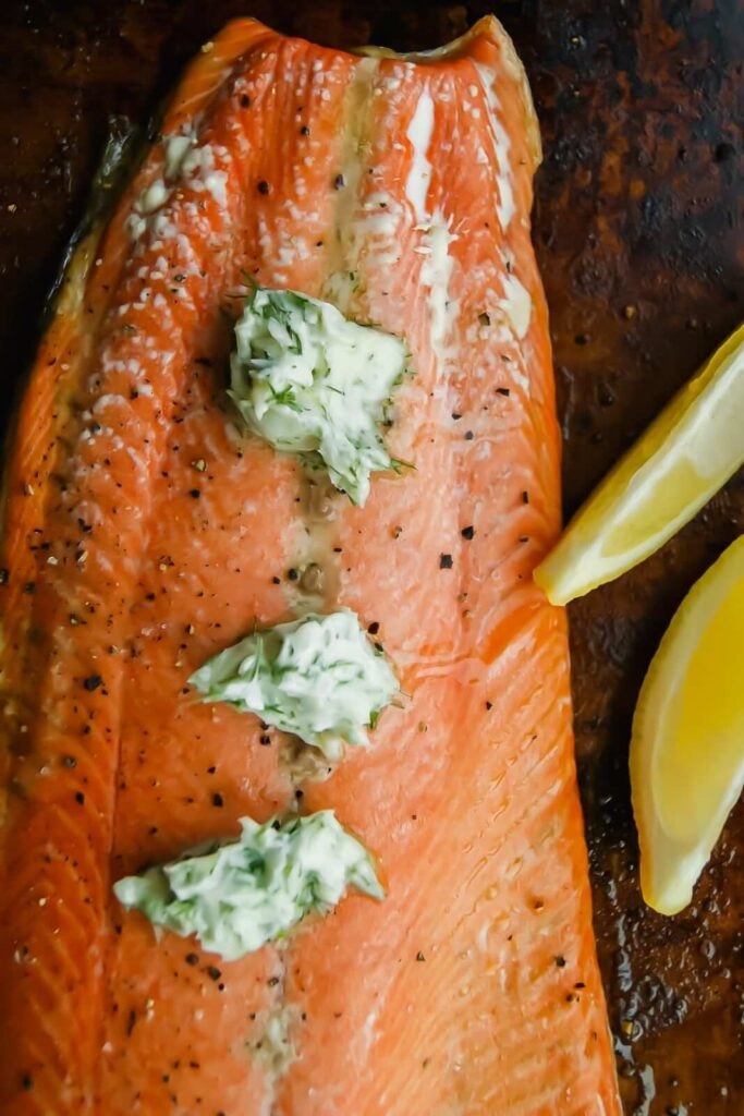 Baked salmon with dill butter on top