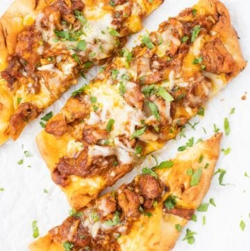 Slices of butter chicken pizza