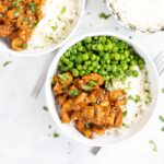 Bowl of crock pot butter chicken and peas
