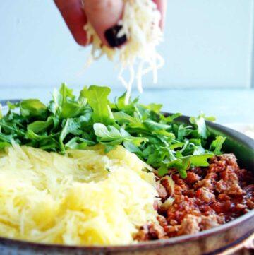 Spaghetti Squash Turkey Parmesan is the familiar flavors you love in a healthy spaghetti squash vessel! Click here for recipe! #glutenfree #spaghettisquash #healthydinner #easydinner #turkey