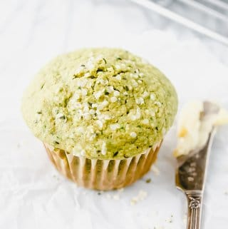 spinach muffin with butter on knife