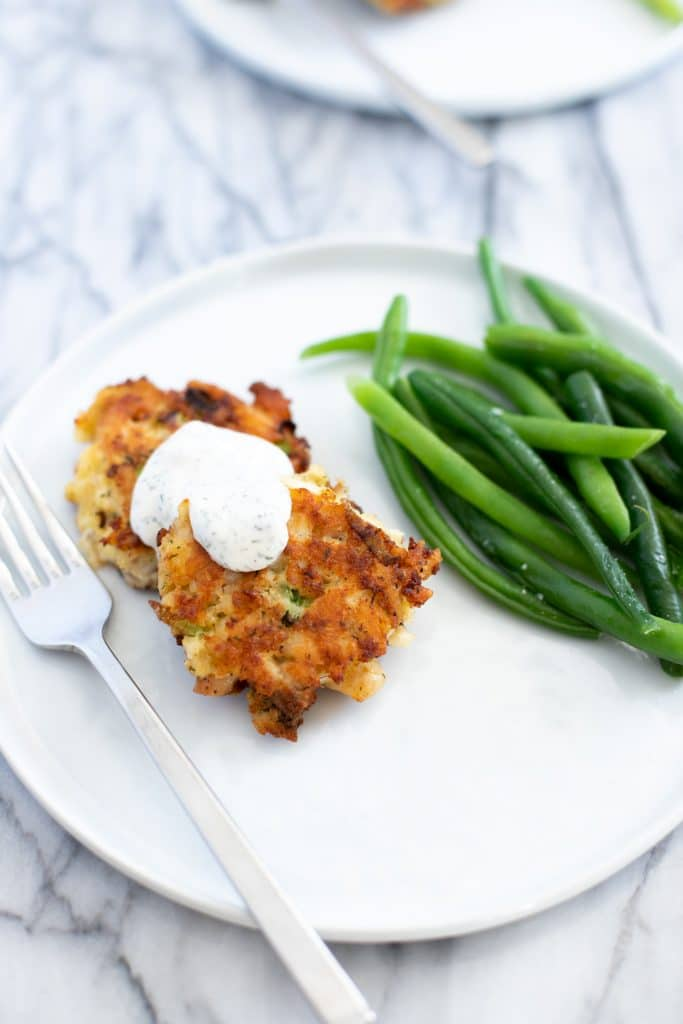 Plate with tilapia fish cakes and green beans