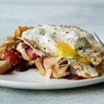 Plate with leftover turkey hash recipe and a fried egg